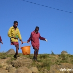 orphans in Africa carry water