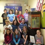 """The grade 4/5 students of Janeville Elementary School manage a weekly popcorn business at the school called """"Popperazzi""""."""