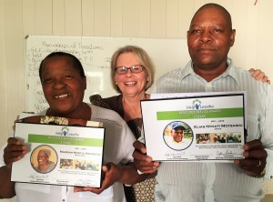 Peg presenting Help Lesotho staff with plaques